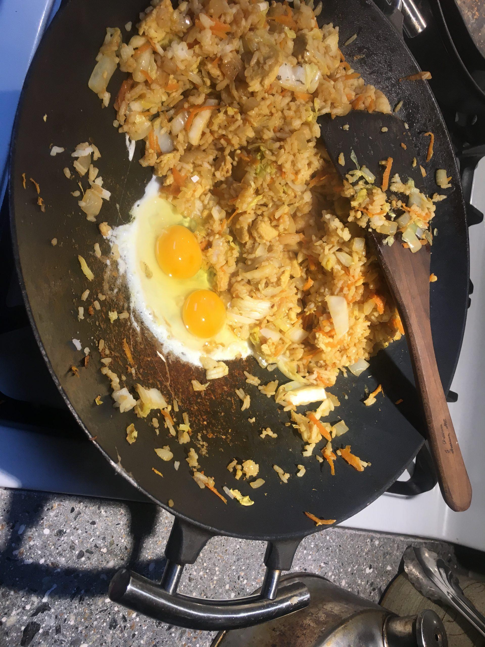 cast iron wok with fried rice